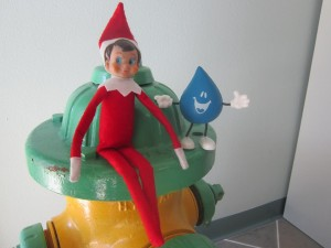Elf on a Shelf with Drippy on a Fire Hydrant
