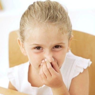Photo of Child Holding Nose