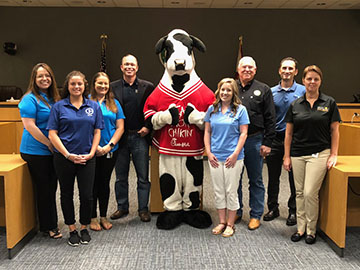 Photo of Senior Managers, County Commissioner, and Chick-Fil-A cow